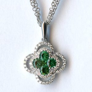 White gold emerald and diamond pendant